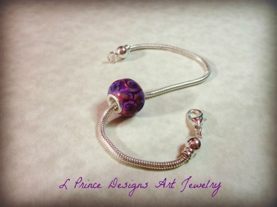 Lori will have a great selection of polymer clay beads for bracelets.