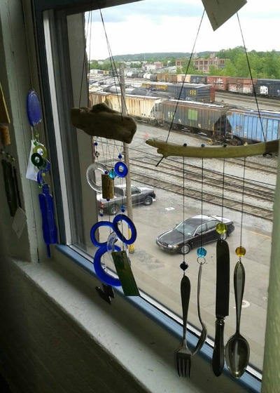 Windchimes by Tom Zachman. Trains by CSX. (You'll be amazed by the artful graffiti on some of the cars!) Hungerford 318.