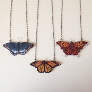 These are woodburned cherry, colored with watercolor pigment, with sterling silver antennae. From left priced $74, $64, and $74. Each butterfly can be found here in New York!