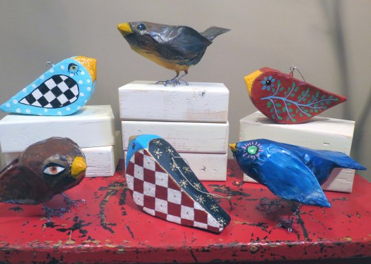 """My papier mache birds are caricatures really. I give them poses and faces that remind me of people, using colorful paint as adornment. The hanging ornaments are a bit more conventional and I'm having a ball exploring ways to highlight that individuality."""