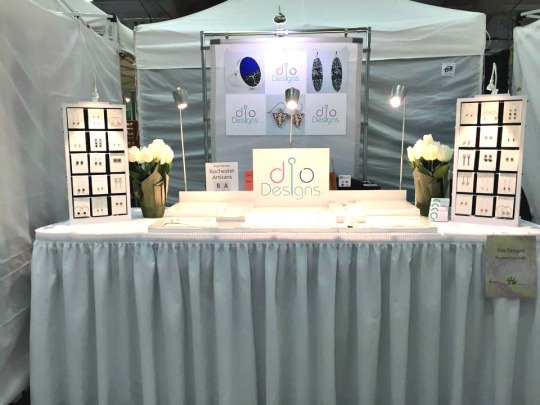 Look how classy her booth set-up is! Aww, her Rochester Artisans sign is right there too...